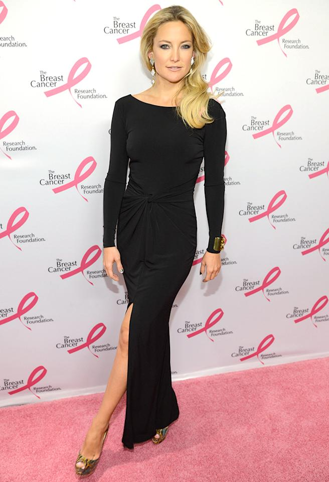 Kate Hudson oozed elegance -- in a long-sleeved, figure-hugging Ann Taylor gown -- as she sauntered down the pink carpet at a breast cancer charity event in NYC on Wednesday evening. The blond bombshell -- who never over accessorizes -- finalized her sophisticated outfit with Erickson Beamon earrings, a gold cuff, and snakeskin peep-toes. (4/17/2013)