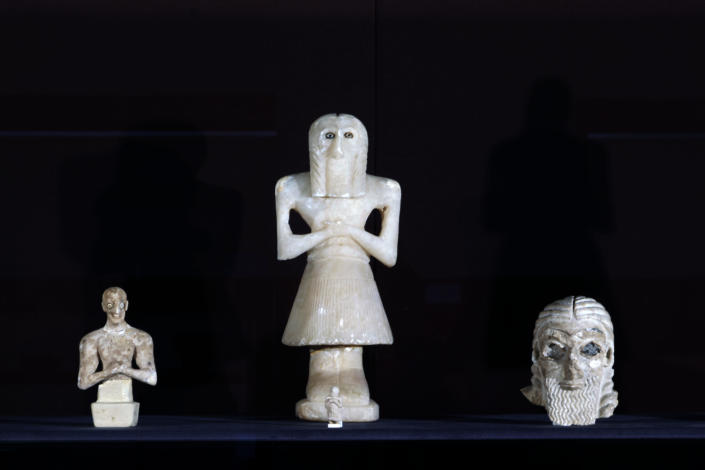 Antiquities are displayed at the Iraqi National Museum in Baghdad, Iraq, Monday, April 1, 2013. Tens of thousands of artifacts chronicling some 7,000 years of civilization in Mesopotamia are believed to have been looted from Iraq in the chaos which followed the the US-led invasion in 2003. Despite international efforts to track items down, fewer than half of the artifacts have so far been retrieved. (AP Photo/Hadi Mizban)