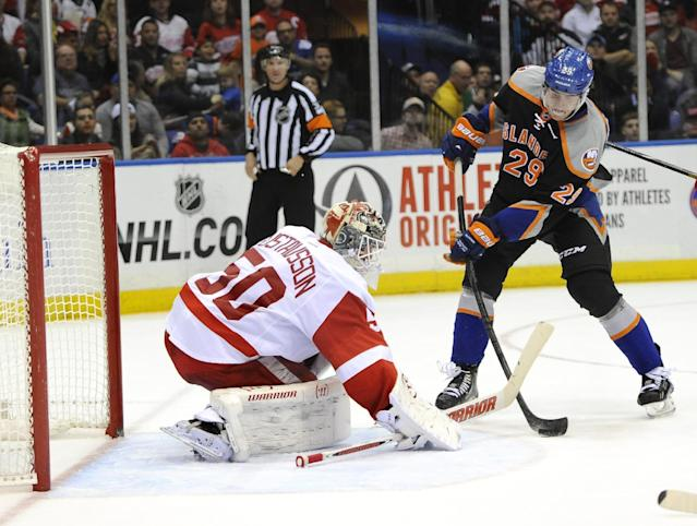 New York Islanders' Brock Nelson (29) lines up the puck to shoot against Detroit Red Wings goalie Jonas Gustavsson (50) to score in the second period of an NHL hockey game on Saturday, Nov. 16, 2013, in Uniondale, N.Y. (AP Photo/Kathy Kmonicek)