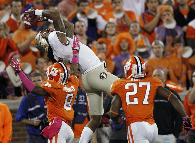 Florida State wide receiver Kelvin Benjamin (1) makes the catch for a touchdown against Clemson cornerback Darius Robinson (8) during the first half of an NCAA college football game, Saturday, Oct. 19, 2013, in Clemson, S.C. (AP Photo/Mike Stewart)