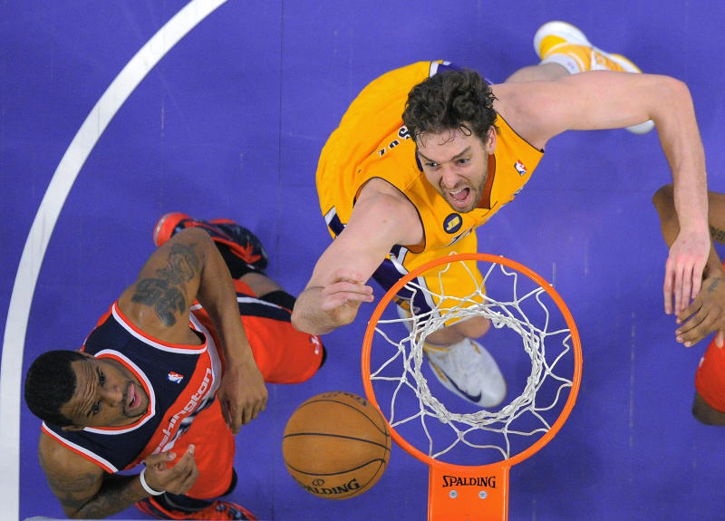 Los Angeles Lakers forward Pau Gasol, right, of Spain, and Washington Wizards forward Trevor Booker go after a rebound during the first half of an NBA basketball game, Friday, March 22, 2013, in Los Angeles. (AP Photo/Mark J. Terrill)