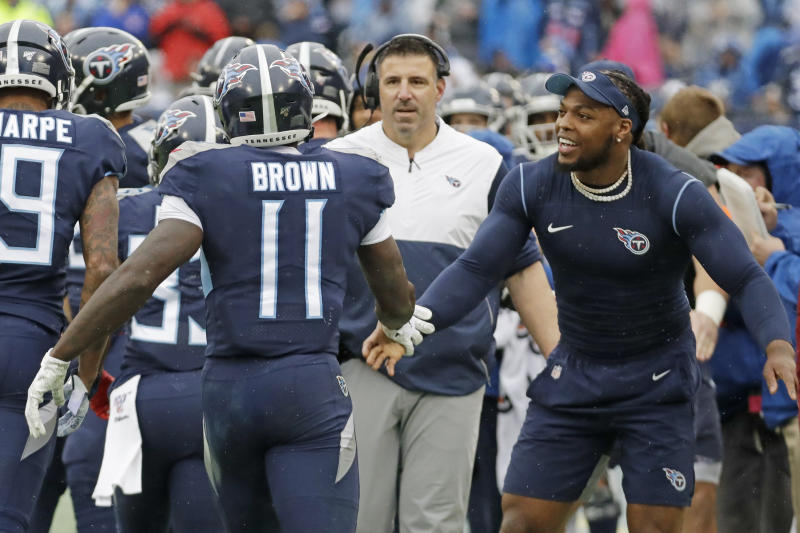 Tennessee Titans wide receiver A.J. Brown (11) is congratulated by running back Derrick Henry, right, after Brown scored a touchdown on a 49-yard run against the New Orleans Saints in the first half of an NFL football game Sunday, Dec. 22, 2019, in Nashville, Tenn. (AP Photo/James Kenney)