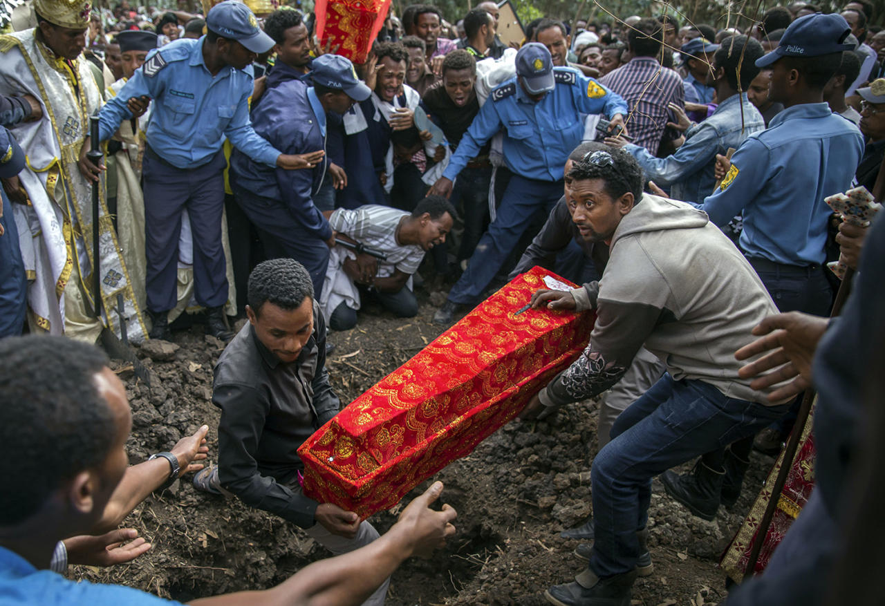 <p>The coffin of one of those killed in the collapse of a mountain of trash at a garbage dump arrives for the burial, at the Gebrekristos church in Addis Ababa, Ethiopia on March 13, 2017. (AP Photo/Mulugeta Ayene) </p>