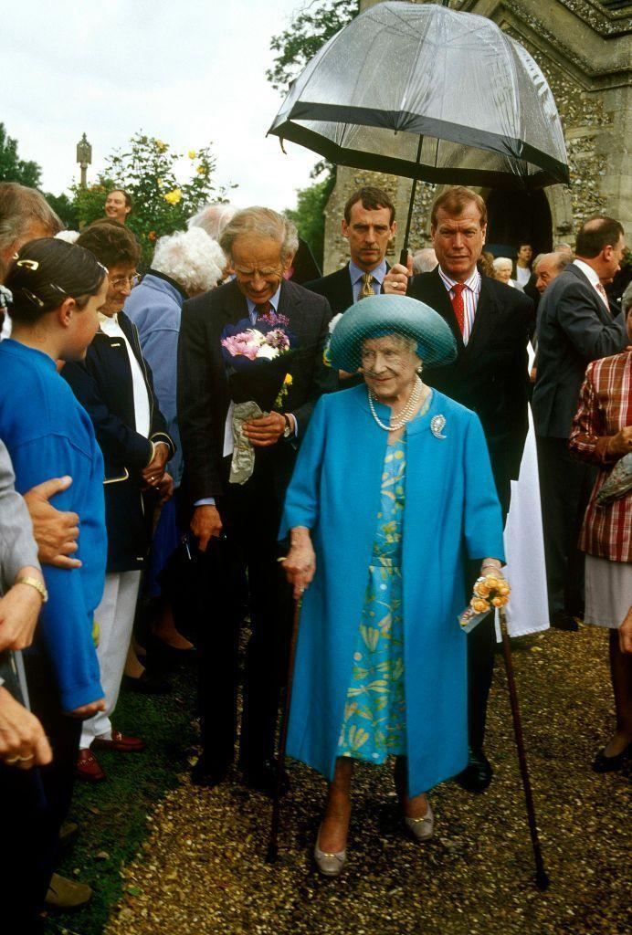 <p>The Queen Mother never shrugged her royal duties, even into her 90s. Here, she uses two canes for support as she leaves a church service in 1990. </p>