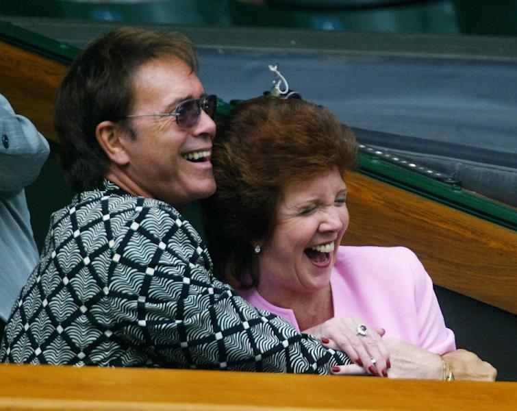 British rocker Sir Cliff Richard (L) and Cilla Black at Wimbledon in July 2003 (AFP Photo/Odd Andersen)