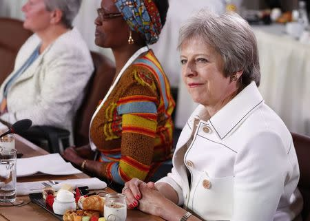 Britain's Prime Minister Theresa May attends a G7 and Gender Equality Advisory Council meeting as part of a G7 summit in the Charlevoix city of La Malbaie