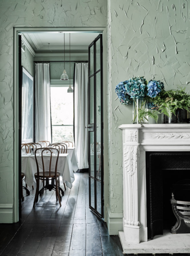 <p>When applied with a flat plaster paddle rather than a roller or brush, paint will give your walls some three-dimensional oomph. This light mossy green wall looks more like a work of art and feels fully integrated into the space instead of just blending in as a backdrop. </p>