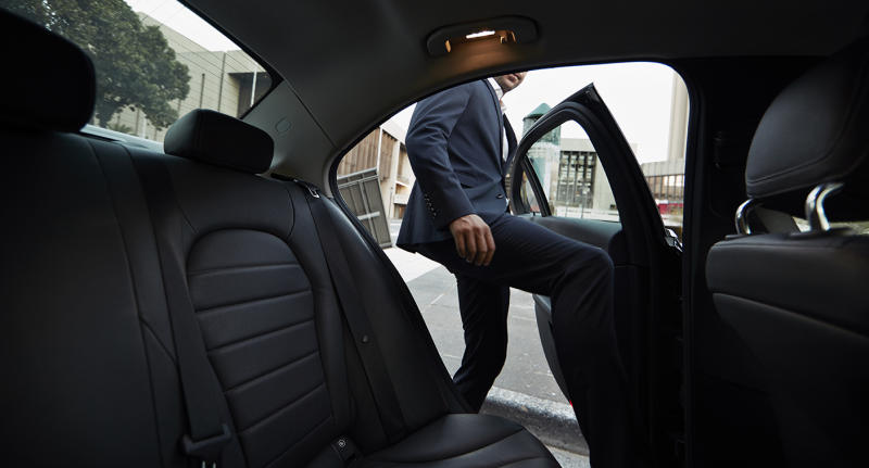 Man getting into backseat of uber