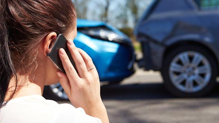 woman telephones after accident