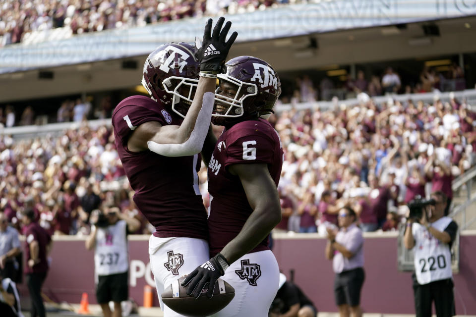 Texas A&M running back Devon Achane (6) reacts with teammate Demond Demas (1) after scoring a touchdown during the first half of an NCAA college football game against New Mexico, Saturday, Sept. 18, 2021, in College Station, Texas. (AP Photo/Sam Craft)