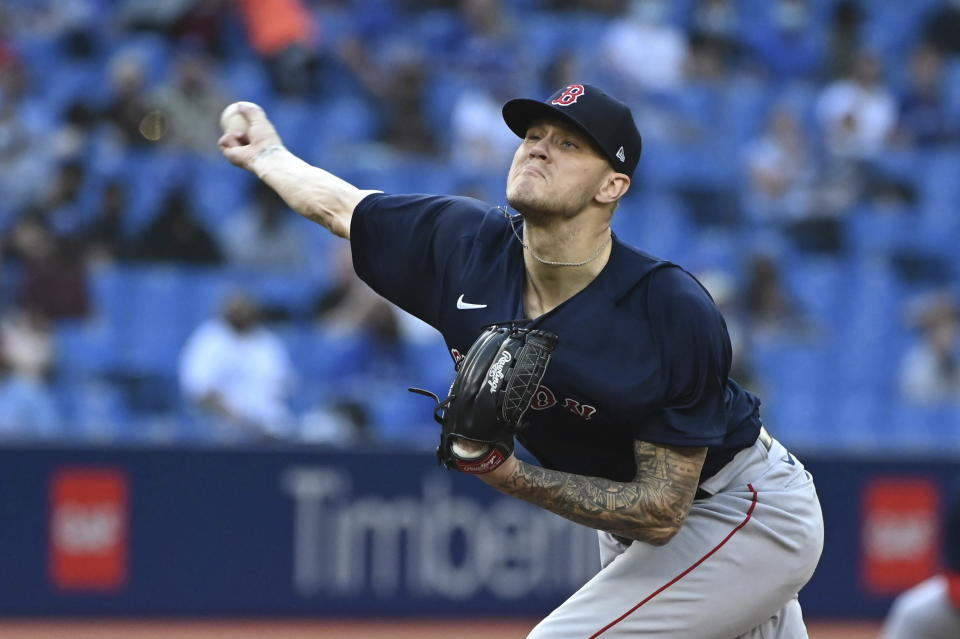 Boston Red Sox starting pitcher Tanner Houck throws in the first inning of the second game of a baseball doubleheader against the Toronto Blue Jays in Toronto, Saturday Aug. 7, 2021. (Jon Blacker/The Canadian Press via AP)