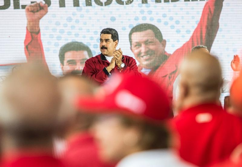 Venezuelan President Nicolas Maduro is shown in this January 31, 2017 file photo at a rally with workers of PDVSA in Caracas