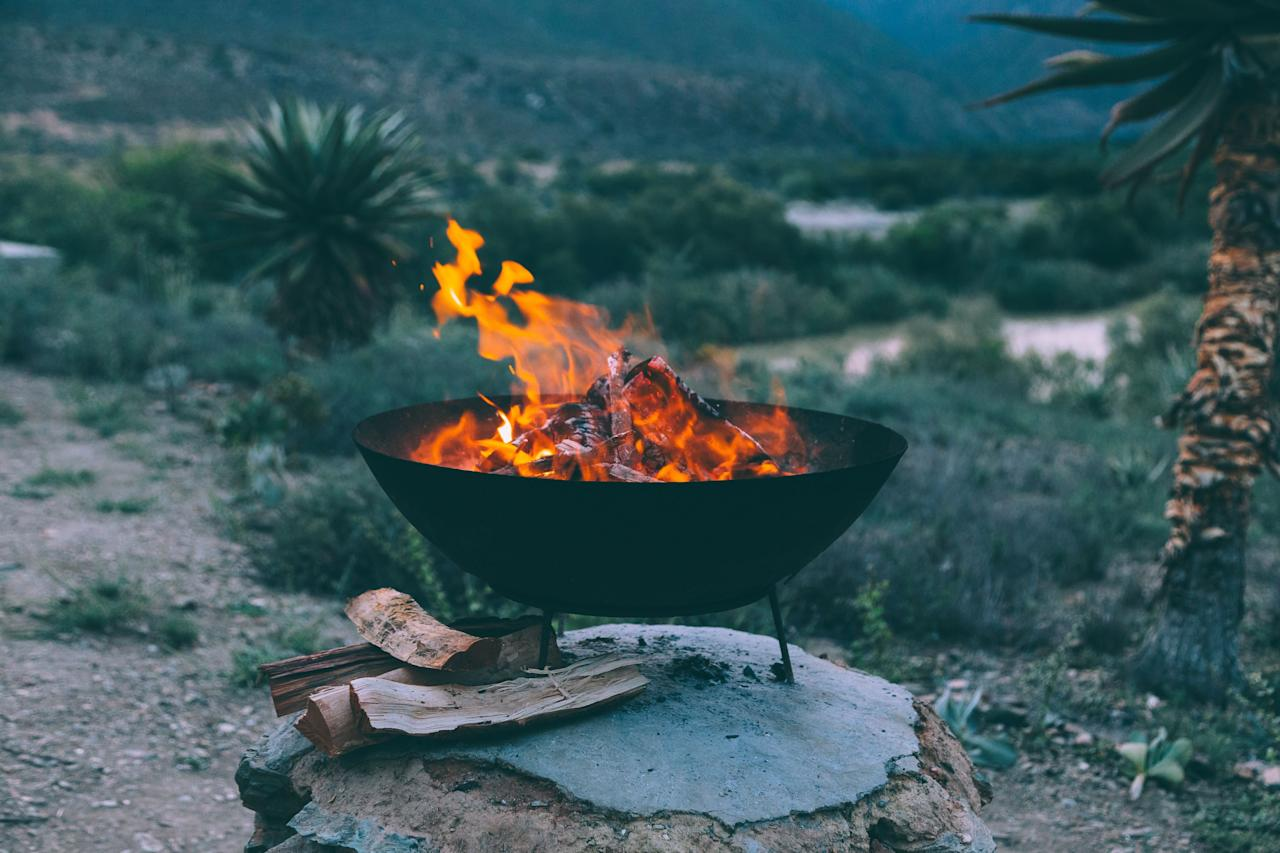 <p>The crisp autumn air, the early nightfall, and the falling leaves make things already feel cozy, so kick it up a level with an outdoor fire pit. A warming, roaring fire helps you extend the outdoor season just a <em>little</em> bit longer. Call your friends, you're throwing a fall bonfire. </p>