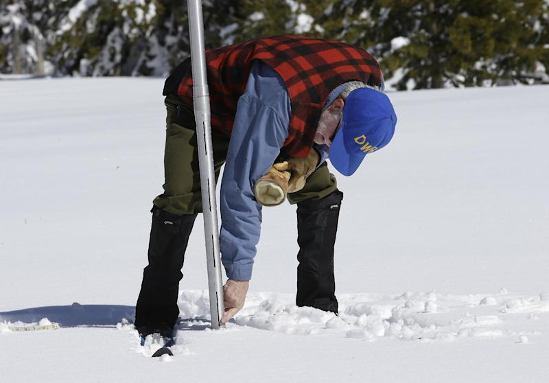 Frank Gehrke, chief of the California Cooperative Snow Surveys Program for the Department of Water Resources, checks the depth of the snowpack as he conducts the third manual snow survey of the season at Phillips Station, Wednesday, March1, 2017, near Echo Summit, Calif. The survey showed the snowpack at 179 percent of normal for this location at this time of year. The state's electronic snow monitors say the Sierra Nevada snowpack is at 185 percent of normal. (AP Photo/Rich Pedroncelli)