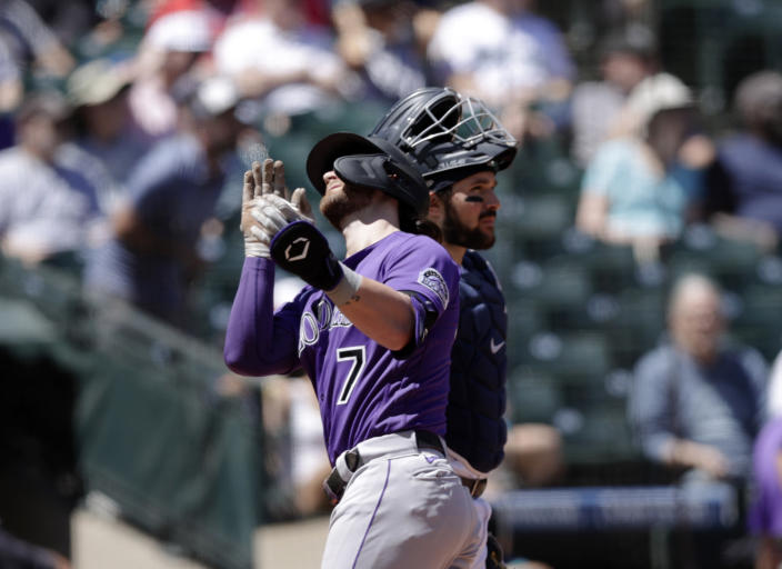 Colorado Rockies' Brendan Rodgers celebrates as he crosses home after hitting a two run home run on a pitch from Seattle Mariners starting pitcher Justus Sheffield during the second inning of a baseball game, Wednesday, June 23, 2021, in Seattle. (AP Photo/John Froschauer)