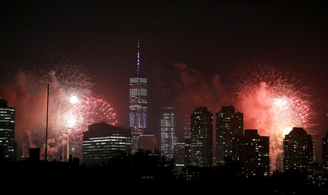 Fireworks explode over buildings from Jersey City, N.J., and New York City's Lower Manhattan, including One World Trade Center, center left, during a Fourth of July celebration, Wednesday, July 4, 2018, in Jersey City, N.J. (AP Photo/Julio Cortez)