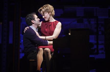 "Anika Larsen (R) and Jarrod Spector perform onstage during the ""Beautiful - The Carole King Musical"" press preview at the Stephen Sondheim Theatre in New York November 21, 2013. REUTERS/Carlo Allegri"