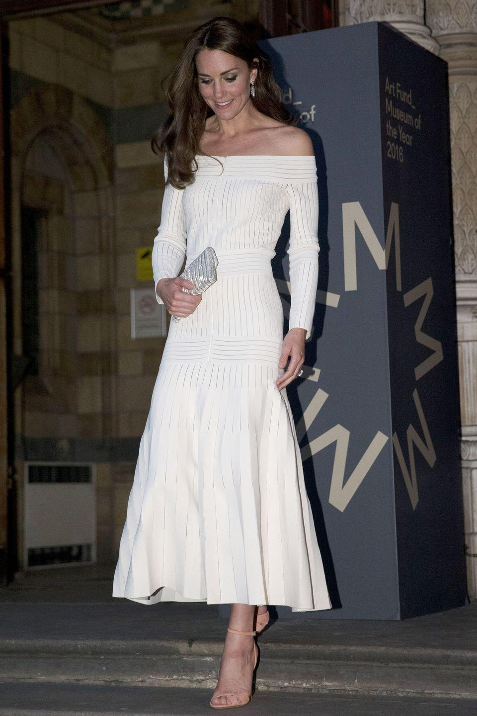 <p>The duchess wore a cream off-the-shoulder, jersey paneled dress by Barbara Casasola with a silver clutch and tan heeled sandals at the Natural History Museum in London.</p>
