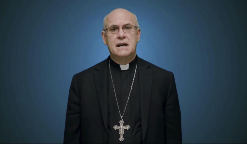 In this photo taken from video, Bishop Kevin Rhoades of Fort Wayne-South Bend, Ind., head of the doctrine committee for the U.S Conference of Catholic Bishops, addresses the body's virtual assembly regarding a formal statement on the meaning of the Eucharist in the life of the church on Thursday, June 17, 2021. (United States Conference of Catholic Bishops via AP)