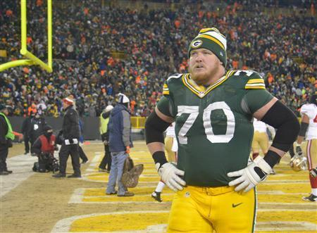 Jan 5, 2014; Green Bay, WI, USA; Green Bay Packers guard T.J. Lang (70) walks off the field after the San Francisco 49ers beat the Packers 23-20 during the 2013 NFC wild card playoff football game at Lambeau Field. Mandatory Credit: Benny Sieu-USA TODAY Sports