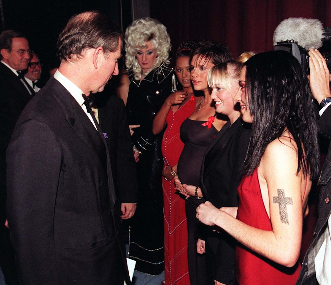<p>The Prince of Wales speaks to the Spice Girls with Mel B and Victoria heavily pregnant, and Emma and Mel C, after the 77th Royal Variety Performance at London's Lyceum Theatre. Lily Savage is not impressed. If looks could kill! (Photo by John Stillwell. WPA Rota.) </p>