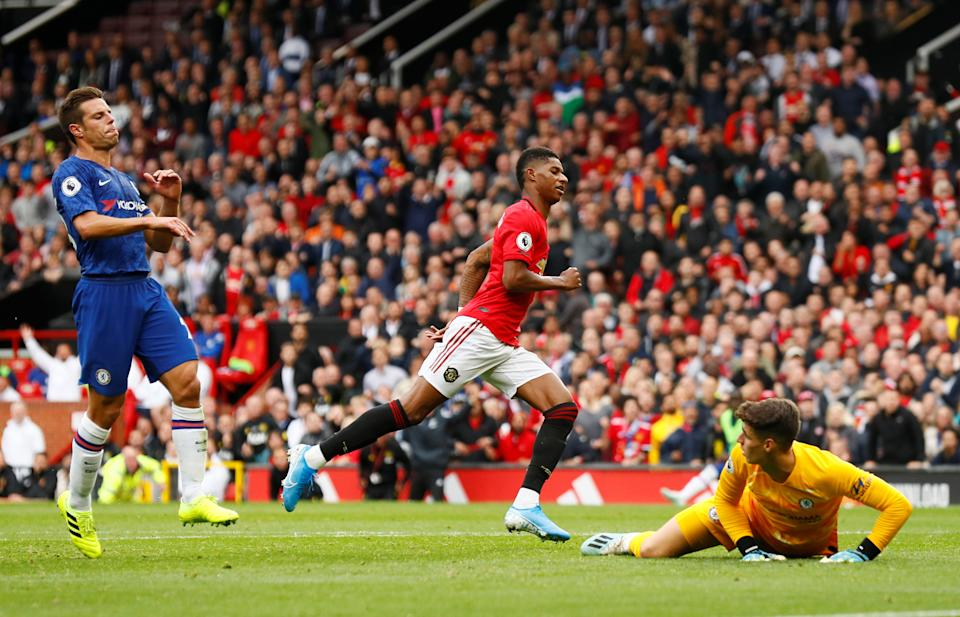 """Soccer Football - Premier League - Manchester United v Chelsea - Old Trafford, Manchester, Britain - August 11, 2019  Manchester United's Marcus Rashford celebrates scoring their third goal as Chelsea's Cesar Azpilicueta and Kepa Arrizabalaga look dejected   Action Images via Reuters/Jason Cairnduff  EDITORIAL USE ONLY. No use with unauthorized audio, video, data, fixture lists, club/league logos or """"live"""" services. Online in-match use limited to 75 images, no video emulation. No use in betting, games or single club/league/player publications.  Please contact your account representative for further details."""