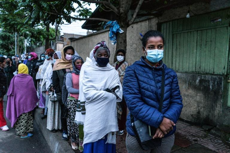 People wait to cast their ballots in Addis Ababa in the first electoral test for Prime Minister Abiy Ahmed, who rose to power championing a democratic revival in Africa's second most populous country