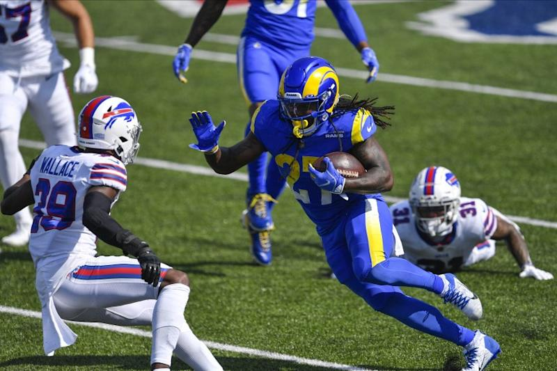 Los Angeles Rams' Darrell Henderson (27) rushes past Buffalo Bills' Dean Marlowe (31) as cornerback Levi Wallace (39) closes in during the first half of an NFL football game Sunday, Aug. 26, 2018, in Orchard Park, N.Y. (AP Photo/Adrian Kraus)