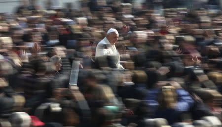 Pope Francis arrives to lead the general audience in St. Peter's Square at the Vatican March 11, 2015. REUTERS/Stefano Rellandini