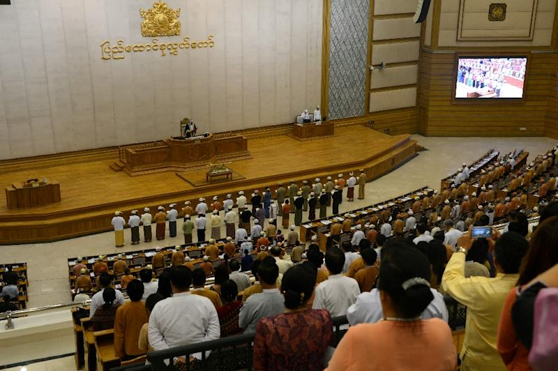 Myanmar ministers are sworn into office by Upper House Speaker Mahn Win Khine (on podium) during a ceremony at the parliament in Naypyidaw on March 30, 2016