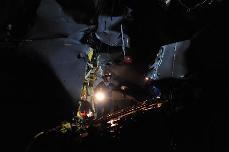 In this photo provided by the U.S. Navy, Sunday, Aug. 12, 2012, personnel examine the guided-missile destroyer USS Porter after it was damaged in a collision with the Panamanian flagged, Japanese-owned bulk oil tanker M/V Otowasan in the Strait of Hormuz early Sunday. (AP Photo/U.S. Navy, Petty Officer 3rd Class Jonathan Sunderman)