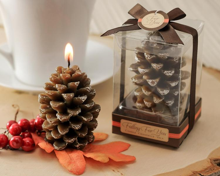 This undated product image provided by Beau-coup.com shows mini cinnamon-scented pine cone candles, a thoughtful party favor for a holiday party. (AP Photo/Beau-coup.com)