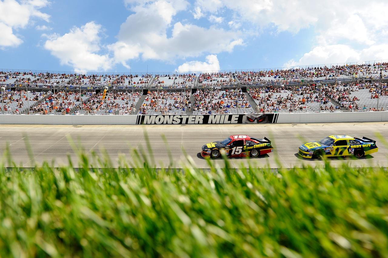 DOVER, DE - JUNE 03:  Clint Bowyer, driver of the #15 5-hour Energy Toyota, leads Matt Kenseth, driver of the #17 Best Buy Ford, during the NASCAR Sprint Cup Series FedEx 400 benefiting Autism Speaks at Dover International Speedway on June 3, 2012 in Dover, Delaware.  (Photo by John Harrelson/Getty Images for NASCAR)