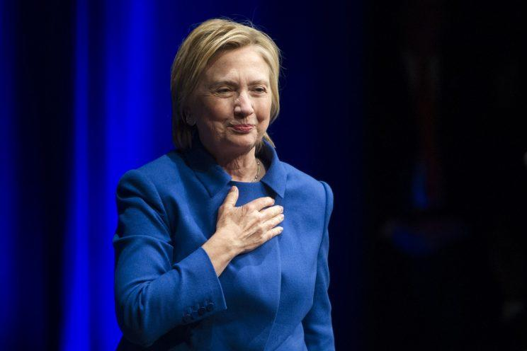 Hillary Clinton places her hand over her hand as she walks to the podium to address the Children's Defense Fund's Beat the Odds celebration at the Newseum in Washington, Wednesday, Nov. 16, 2016. (AP Photo/Cliff Owen)