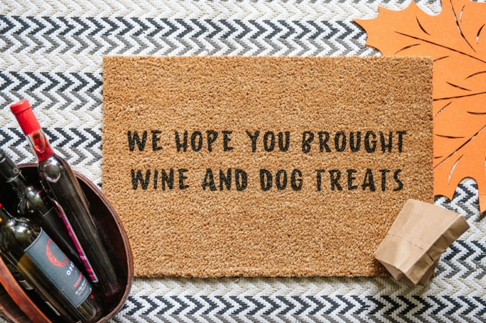'We Hope You Brought Wine and Dog Treats' Door Mat (Photo via Etsy)