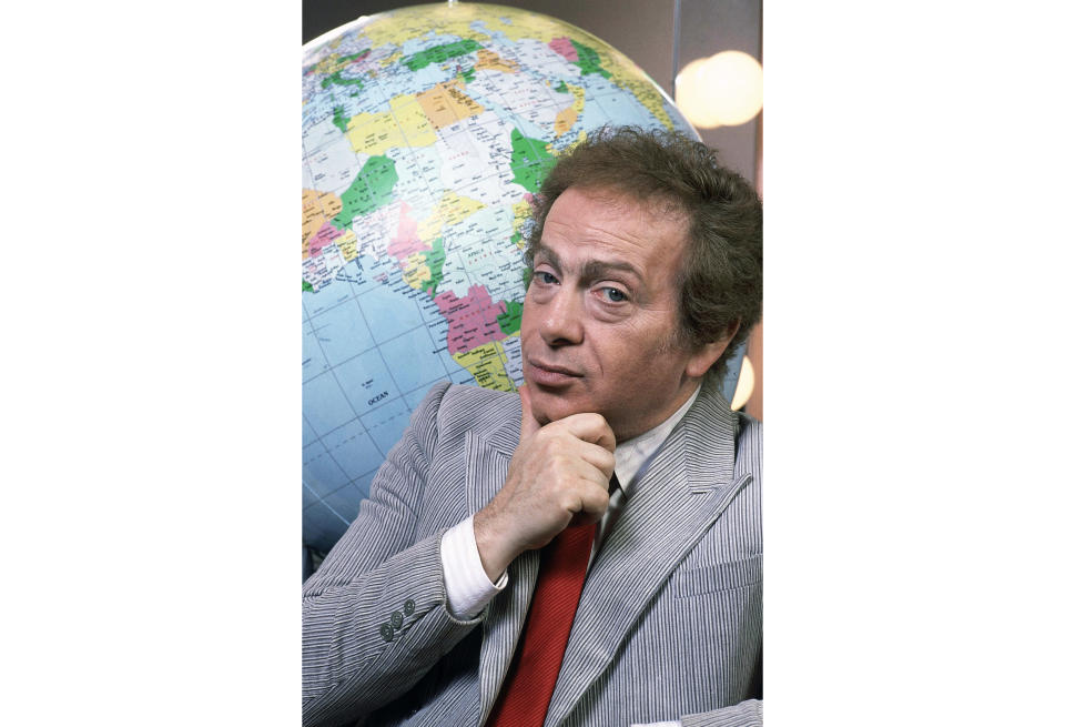 FILE - In this Jan. 27, 1987, file photo, Jackie Mason poses in his dressing with a globe as he stars in his own Broadway show in New York. Mason, a rabbi-turned-jokester whose feisty brand of standup comedy got laughs from nightclubs in the Catskills to West Coast talk shows and Broadway stages, has died. He was 93. Mason died Saturday, July 24, 2021, in Manhattan, the celebrity lawyer Raoul Felder told The Associated Press. (AP Photo/Carlos Rene Perez, File)