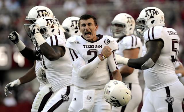 FILE - This Nov. 10, 2012 file photo shows Texas A&M quarterback Johnny Manziel (2) celebrating after a review proves an Aggie touchdown during the first half of their first SEC meeting against Alabama in an NCAA college football game in Tuscaloosa, Ala. Manziel has become the first freshman to be voted The Associated Press Player of the Year in college football, Tuesday, Dec. 18, 2012. (AP Photo/The Decatur Daily, Gary Cosby Jr., File)