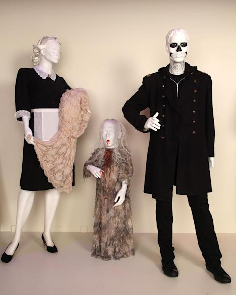 """In this publicity photo provided by Fashion Institute of Design & Merchandising, costumes from the TV show, """"American Horror Story,"""" are shown in the exhibit """"The Outstanding Art of Television Costume Design"""" at FIDM in Los Angeles. """"American Horror Story"""" is nominated for 2012 Emmy® for Outstanding Costume Design by Series Costume Designer, Chrisi Karvonides and Series Costume Supervisor, Conan Castro. Additional costumes by Pilot Costume Designer, Lou Eyrich, Pilot Co-Costume Designer, Jennifer Eve. (AP Photo/FIDM, Alex J. Berliner)"""
