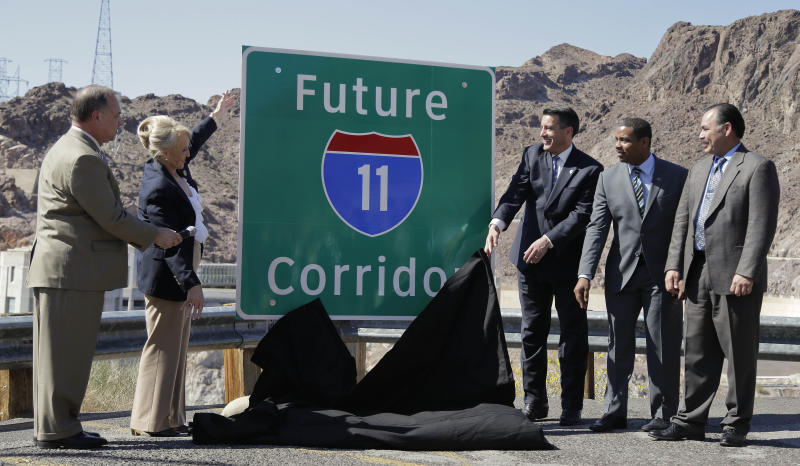 <p> From left, Arizona Department of Transportation director John Halikowski, Arizona governor Jan Brewer, Nevada governor Brian Sandoval, Steven Horsford, D-Nev., and Nevada Department of Transportation director Rudy Malfabon unveil a sign that will mark the corridor for the future Interstate 11 between Phoenix and Las Vegas, Friday, March 21, 2014, at Hoover Dam, Ariz. It was a symbolic effort meant to keep up momentum on the project, which is coming of age in an era of scarce highway funding. (AP Photo/Julie Jacobson) </p>