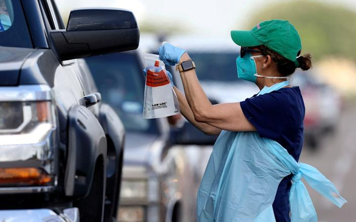 Health officials and the military assist during Covid-19 testing in Texas - Delcia Lopez/The Monitor via AP
