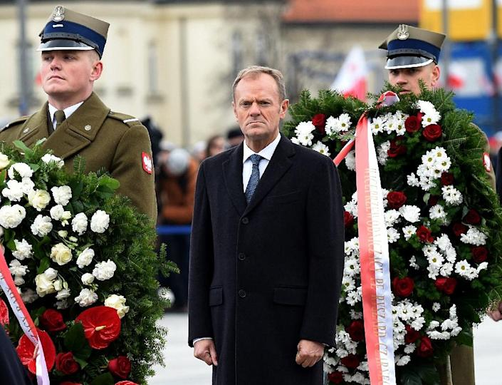 Former Polish prime minister and European Council President Donald Tusk lays a wreath at the Tomb of the Unknown Soldier in Warsaw attending ceremonies on Poland's Independence Day for the first time since rival conservative PiS party came to power. (AFP Photo/JANEK SKARZYNSKI)