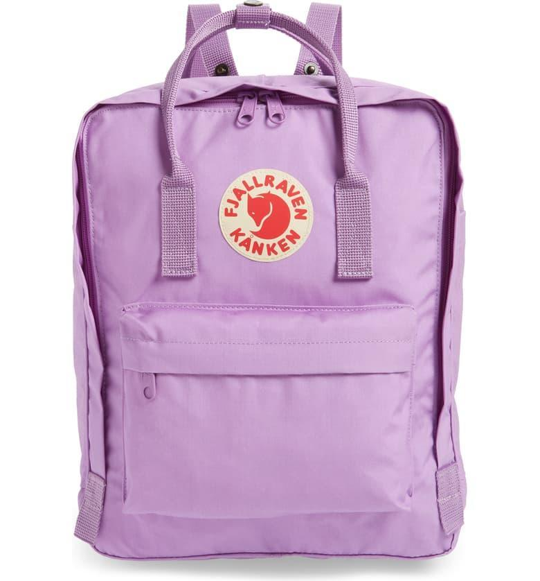 """This Scandinavian bag is a timeless favorite. It's super versatile and can be carried like a handbag <em>or</em> worn on your back. The water-resistant nylon backpack can hold all your books, a 13"""" laptop, and miscellaneous gadgets. It has a dual-zip closure on the main compartment and a front pocket to store smaller items like your cellphone. It's available in 40 shades, including orchid (seen here.) And, if you prefer something smaller, you'll be happy to know this exact design is also available as a <a href=""""https://cna.st/affiliate-link/AqefbiEiZtJ8ngT85BUnDv3MgzLTA4J6dhFV6kMJguNxF2B4AVR1civ2gSnkQ3fPVUh48zBDknd9ki5KasknJsveUqFELnDoj8ocWewMTdTcxtSM3fBeWut9tNFoq463kf2q9w4WB2AK5F5BW6uBJ7ZNr?cid=55826646a28d9d4e05408080"""" rel=""""nofollow noopener"""" target=""""_blank"""" data-ylk=""""slk:mini backpack"""" class=""""link rapid-noclick-resp"""">mini backpack</a>. $80, Nordstrom. <a href=""""https://www.nordstrom.com/s/fjallraven-kanken-water-resistant-backpack/3833666"""" rel=""""nofollow noopener"""" target=""""_blank"""" data-ylk=""""slk:Get it now!"""" class=""""link rapid-noclick-resp"""">Get it now!</a>"""