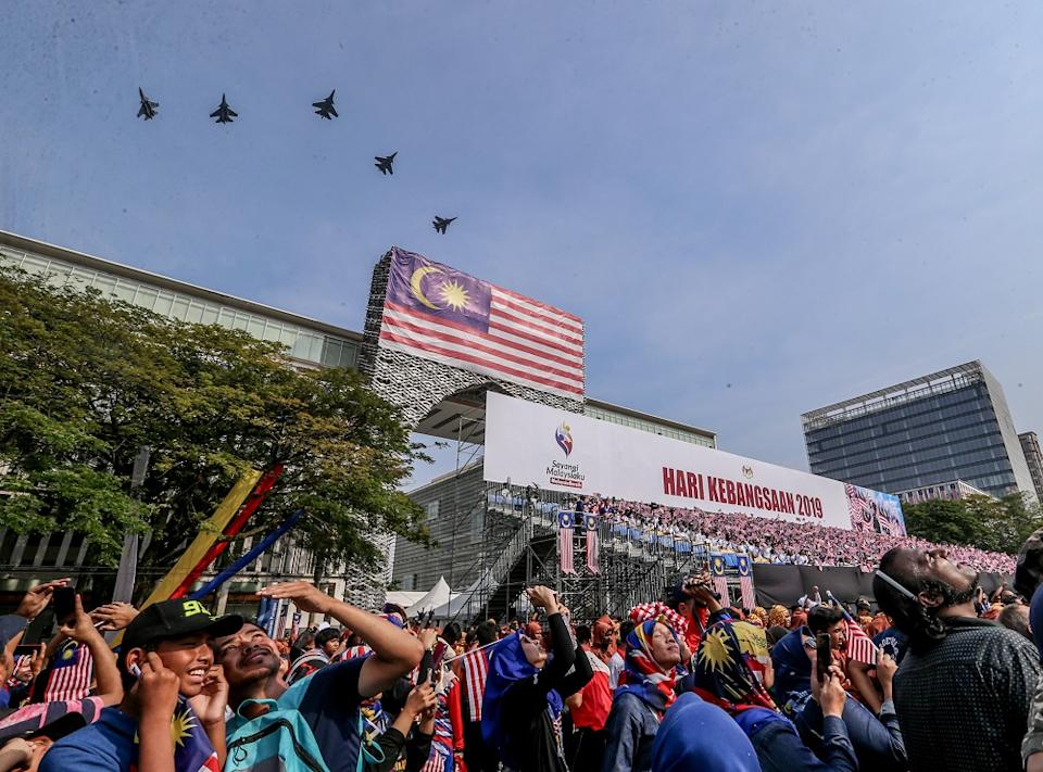 Malaysian Royal Air Force fighter jets fly above the crowd during the National Day Parade held at Dataran Putrajaya 31 August 2019. — Picture by Firdaus Latif