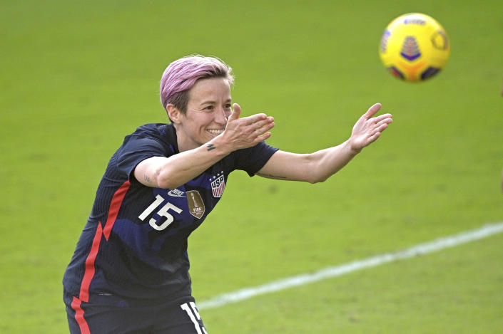 United States forward Megan Rapinoe (15) acknowledges fans in the stands after scoring a goal during the second half of a SheBelieves Cup women's soccer match against Brazil, Sunday, Feb. 21, 2021, in Orlando, Fla. (AP Photo/Phelan M. Ebenhack)