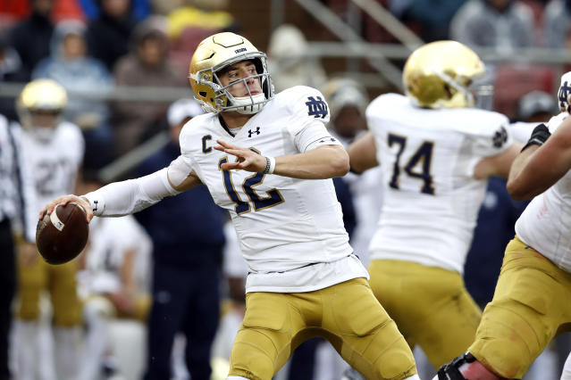 Notre Dame Fighting Irish quarterback Ian Book (12) throws a pass during the second quarter against the Stanford Cardinal. (USA Today Sports)