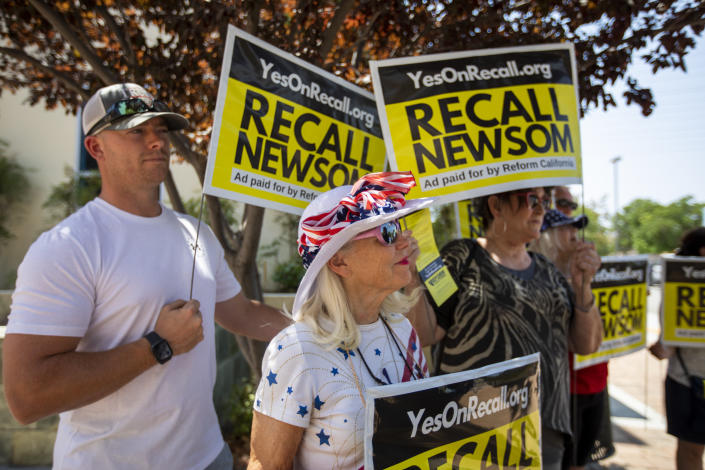 Vicky Abramson, middle, of Valencia is attending  a rally at the Santa Clarita Activities Center on Sunday, Aug. 15, 2021 in SANTA CLARITA, CA. (Francine Orr/Los Angeles Times via Getty Images)