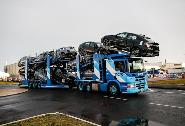 A lorry with car carrier trailer leaves the Honda car plant in Swindon, Britain. Photo: Eddie Keogh/Reuters