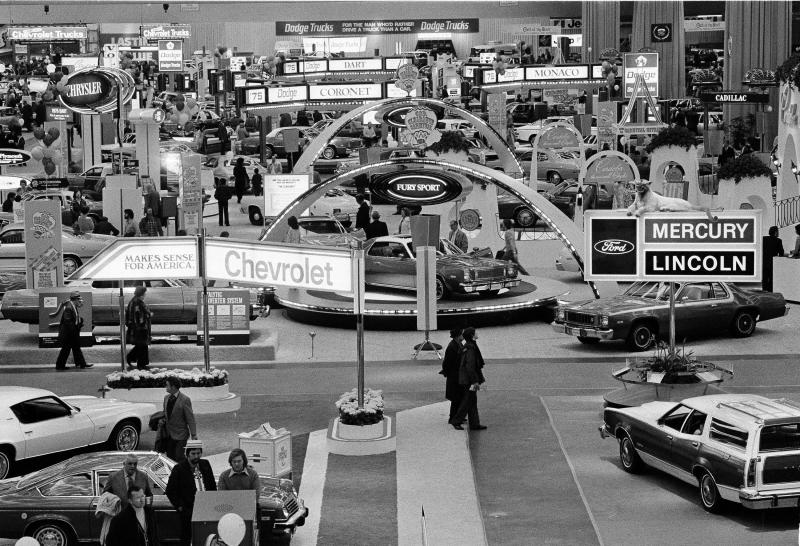FILE - In this Jan. 15, 1975 file photo, crowds visit the 59th Detroit Auto Show in the Cobo Arena in Detroit. Hundreds of thousands of buyers and car fans are expected to crowd Detroit's North American International Auto Show in 2014. (AP Photo/File)