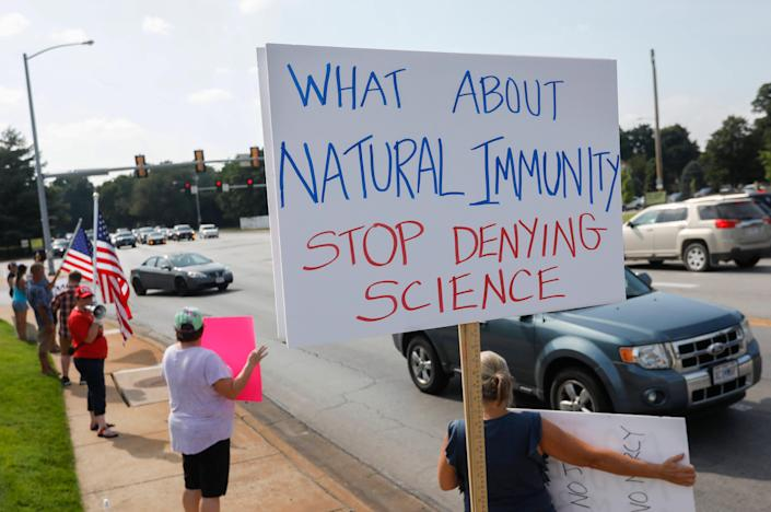 Protesters object to a requirement that employees at Mercy Hospital in Springfield, Missouri, get vaccinated against COVID-19.