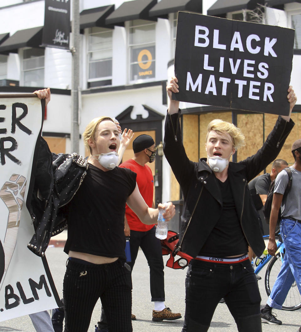 Photo by: zz/GOTPAP/STAR MAX/IPx 2020 6/2/20 Identical twins John Grimes and Edward Grimes - aka Jedward - join demonstrators on June 2, 2020 in Los Angeles, California in protest over the death of George Floyd who died while being arrested by police officers in Minneapolis, Minnesota on May 25th.